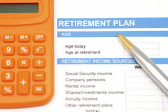 Retirement plan document with pen and calculator Stock Photography