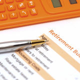 Retirement plan document with pen and calculator Royalty Free Stock Photos