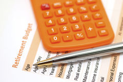 Retirement plan document with pen and calculator Stock Images