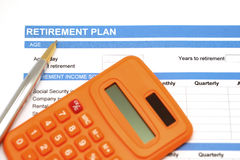 Retirement plan document with pen and calculator Royalty Free Stock Images