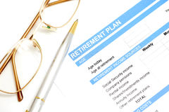 Retirement plan document with pen and glasses Stock Photography