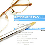 Retirement plan document with pen and glasses Royalty Free Stock Photos