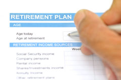 Retirement plan document with pen Stock Photo