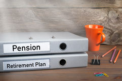 Retirement Plan and Pension - two folders on wooden office desk.  royalty free stock image