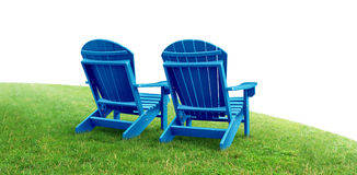 Retirement Planning. Symbol with two empty blue adirondack lawn chairs sitting on green grass as a financial concept of future successful investment strategy on Stock Photography