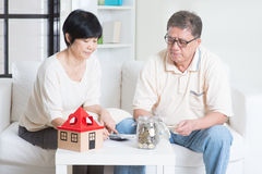 Retirement planning. Asian senior couple counting on money. Saving, retirement plan, retirees financial planning concept. Family living lifestyle at home royalty free stock photos