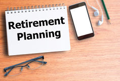 Retirement planning on blank notebook Royalty Free Stock Photos