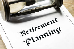 Retirement planning. Concept with hourglass in the background Stock Photo