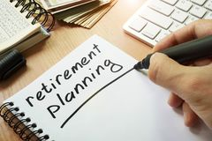 Retirement planning. Retirement planning handwritten in a note royalty free stock image