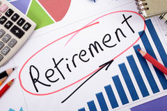 Retirement planning, pension fund growth. The word Retirement written on a bar graph surrounded by pencils, books and calculator Royalty Free Stock Photo