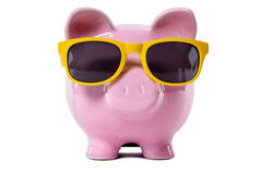 Retirement saving, travel money concept, Piggybank wearing sunglasses Royalty Free Stock Images