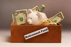 Retirement savings in box. A retirement fund or savings account in a box Royalty Free Stock Photo