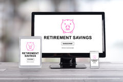 Retirement savings concept on different devices Stock Photo