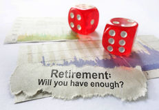 Retirement savings. Retirement newspaper headline with dice and stock market charts Stock Image