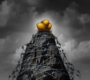 Retirement Savings Security. Investment business concept as a high mountain cliff wrapped with dangerous barbed wire as an insurance symbol for protecting Royalty Free Stock Image