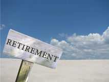 Retirement sign. With clouds and skyline background Stock Photos