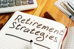 Retirement strategies and pension plan. Notebook and pen. Retirement strategies and pension plan concept. Notebook and pen stock images