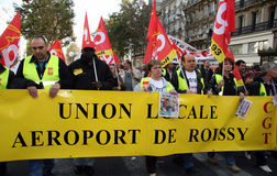 Retirement strike in Paris. PARIS - OCTOBER 28: The CGT trade union of the Roissy Airport activists march during the strike against the retirement age reform on Royalty Free Stock Photography