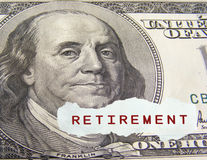 Retirement. Text on a paper scrap over one hundred dollar on foreground Royalty Free Stock Photography