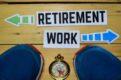 Retirement or Work opposite direction signs with sneakers and compass on wooden stock photos