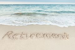 Retirement written on sand by sea. At beach royalty free stock photo