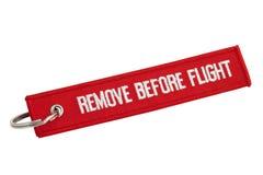 Retirez avant étiquette de rouge de vol Photo stock