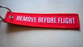Retirez avant étiquette de rouge de vol Photographie stock