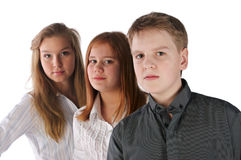Retén del muchacho y de dos muchachas en línea Imagen de archivo libre de regalías