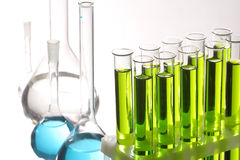 Retort and test tubes. On white Royalty Free Stock Photo