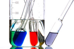 Retorts with coloured liquids Stock Photos