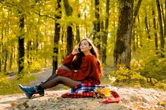 Retouched and natural light. Romantic Autumn Woman Model. Romantic Young Woman on Natural Background Outdoors. Copy. Space for text. Autumn woman having fun at royalty free stock photo