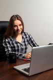 Retoucher works using laptop Royalty Free Stock Image