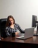 Retoucher works using laptop Stock Photo