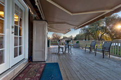 Retractable Awning. Cozy sideyard and deck with a tractable awning royalty free stock images
