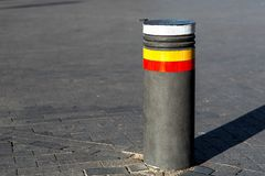 Retractable bollards on paving slabs. royalty free stock images