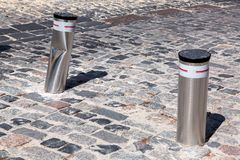 Retractable electric bollard metallic, crash car accident. Retractable electric bollard metallic, and hydraulic for the control of road traffic locked up Royalty Free Stock Photography