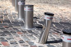 Retractable electric bollard metallic, crash car accident. Retractable electric bollard metallic, and hydraulic for the control of road traffic locked up Royalty Free Stock Photos