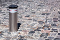 Retractable Electric Bollard Metallic. Retractable Electric Bollard Metallic, and hydraulic for the control of road traffic locked up underground Stock Images
