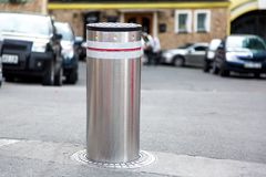 Retractable Electric Bollard Metallic. Retractable Electric Bollard Metallic, and hydraulic for the control of road traffic on the background of the building Royalty Free Stock Photos