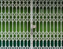 Retractable folding gate closed in front a shop Royalty Free Stock Image