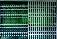 Retractable folding green door gate Stock Photography