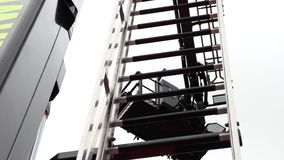 Retractable ladder on the fire truck. Retractable ladder on the roof of a fire truck, closeup view from below stock footage