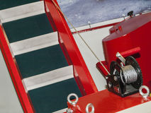 Retractable ladder winch. Ladder on wheels in which the tilt angle varies with the manual winch Stock Images