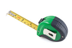 Retractable measuring tape in a white background Royalty Free Stock Image