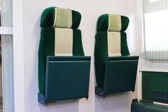 Retractable train seats Royalty Free Stock Image