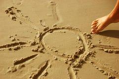 Retrait de Sun sur le sable Photos stock