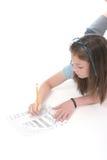 Retrait et écriture 4 de jeune fille Images libres de droits