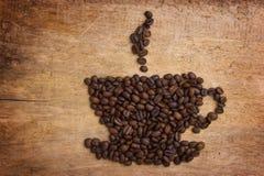 Retrate uma chávena de café feita dos feijões Imagens de Stock