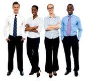 Retrato à moda de quatro executivos foto de stock