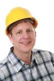 Retrato alegre do trabalhador da construção isolado Fotografia de Stock Royalty Free